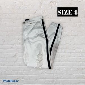 White jeans with black trim